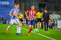 April 19, 2018 - San Sebastian, Spain - Saul Niguez of Atletico Madrid duels for the ball with Aritz Elustondo of Real Sociedad during the Spanish league football match between Real Sociedad and Atletico Madrid at the Anoeta Stadium on 19 April 2018 in San Sebastian, Spain  (Credit Image: © Jose Ignacio Unanue/NurPhoto via ZUMA Press)