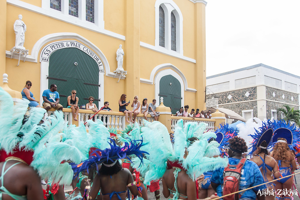 Spectators watch Carnival activities from Sts. Peter & Paul Cathedral.  Carnival 2017 Adults' Parade.  Charlotte Amalie.  St. Thomas, USVI.  29 April 2017.  © Aisha-Zakiya Boyd