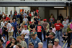 People are seen leaving from the crowd at a rally of Republican presidential candidate Donald Trump, in Mannheim, Lancaster County, PA , on October 1, 2016.