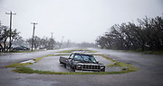 A vehicle sits abandoned in flood water on Saturday, Aug. 26, 2017, in Rockport, Texas. Hurricane Harvey hit the Texas coast as a Category 4 storm, damaging buildings and leaving tens of thousands of people without power. NICK WAGNER / AMERICAN-STATESMAN