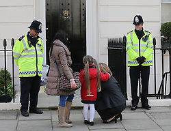 A young  girl and her family look at the flowers outside Baroness Thatcher's house in London, Wednesday, 10th April 2013 Photo by: Stephen Lock / i-Images<br /> <br /> File photo - One year ago: Baroness Thatcher died.<br /> On Tue, Apr 8 2014 it will be one year since the Longest-serving UK Prime Minister of the 20th century, the first and only woman to serve in the role to date, died on April 8, 2013  after suffering a stroke.