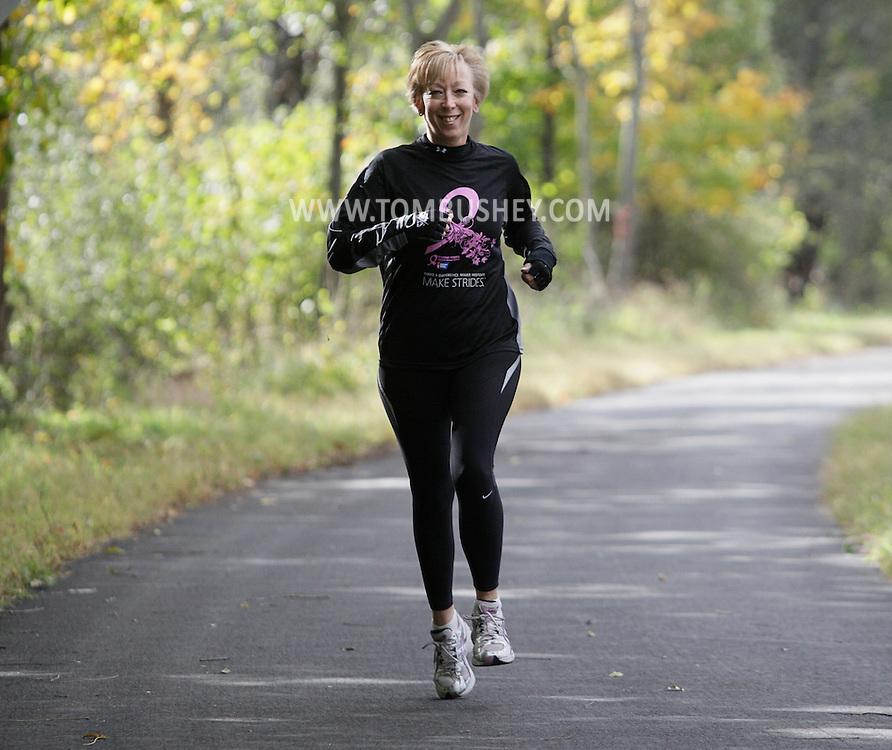 Jackie Duczeminski of Middletown runs on the Heritage Trail in Goshen on Thursday, Oct. 8, 2009.