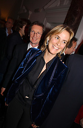 MR DAVID and the HON.MRS MONTGOMERY at a party hosted by jeweller Theo Fennell and Dominique Heriard Dubreuil of Remy Martin fine Champagne Cognac entitles 'Hot Ice' held at 35 Belgrave Square, London, W1 on 26th October 2004.<br />