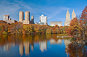 The Lake in Central Park, New York City in Autumn with a view of the Central Park West skyline and, from left, the Majestic, the Dakota and San Remo Apartments.