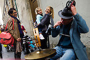 PARIS, FRANCE – SEPTEMBER 24, 2012: Blues-rock guitarist  and street performer René Miller busks among pedestrians.
