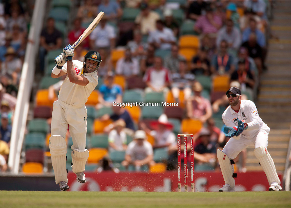 Michael Hussey drives Graeme Swann for four during his 195 in the first Ashes Test Match between Australia and England at the Gabba, Brisbane. Photo: Graham Morris (Tel: +44(0)20 8969 4192 Email: sales@cricketpix.com) 27/11/10