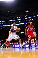 18 November 2012: Guard (24) Kobe Bryant of the Los Angeles Lakers drives to the basket while being guarded by (54) Patrick Patterson of the Houston Rockets during the second half of the Lakers 119-108 victory over the Rockets at the STAPLES Center in Los Angeles, CA.