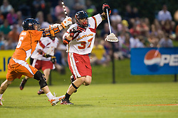 Maryland defenseman Brian Farrell (37) tries to avoid Virginia attackman Ben Rubeor (6).  The #3 ranked Virginia Cavaliers defeated the #8 ranked Maryland Terrapins 11-8 in the semi finals of the Men's 2008 Atlantic Coast Conference tournament at the University of Virginia's Klockner Stadium in Charlottesville, VA on April 25, 2008.