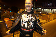 Status Quo fan shows off rock band merchandising in street outside L'Aeronef in Lille, France during group's European tour.