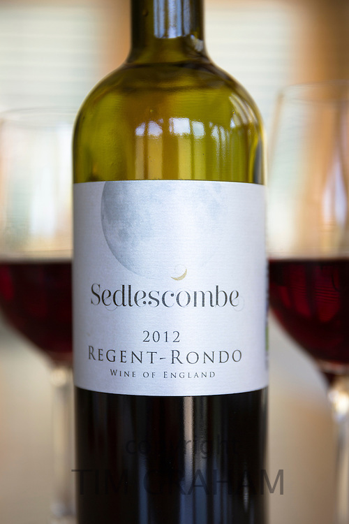 Label of English wine - Bottle of Sedlescombe red wine Regent Rondo poured into wine glasses from Sedlescombe Vineyard, Kent, UK