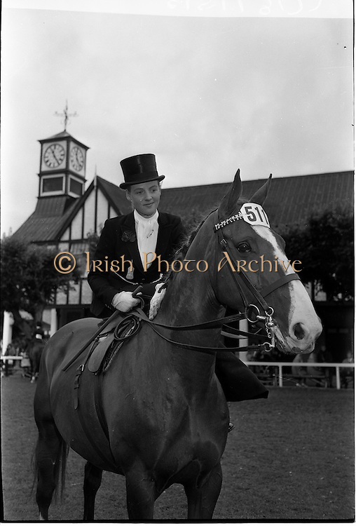"09/08/1962<br /> 08/09/1962<br /> 09 August 1961<br /> RDS Horse Show, Ballsbridge Dublin, Thursday. <br /> Picture shows ""Louise"", a hunter mare owned by Mr R.G. Patton of Kilnacloy, Monaghan and ridden by the Marchioness of Headfort, Kells, Co. Meath in the Ladies Hunter Ridden Side-saddle competition at the show."