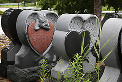 June 25, 2017 - Ontario, ONTARIO, Canada - Newly made granite tombstones outside the workshop of a tombstone designer in Mississauga, Ontario, Canada. (Credit Image: © Creative Touch Imaging Ltd/NurPhoto via ZUMA Press)
