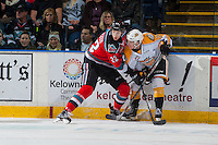 KELOWNA, CANADA - DECEMBER 3: Braydyn Chizen #22 of the Kelowna Rockets checks Connor Gutenberg #24 of the Brandon Wheat Kings at the board on December 3, 2016 at Prospera Place in Kelowna, British Columbia, Canada.  (Photo by Marissa Baecker/Shoot the Breeze)  *** Local Caption ***