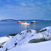 Three lobster boats in winter at Sprucehead, Maine