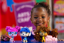 © Licensed to London News Pictures. 27/06/2013. London, UK. Jayla, 3, is seen with three 'VIP pets' (Hamleys price GB£14 each) at the Christmas in June press event at Hamleys toy shop in London today (27/06/2013).  Held in retailers world famous Regents Street store, the event showcases the predicted top toys for Christmas 2013. Photo credit: Matt Cetti-Roberts/LNP