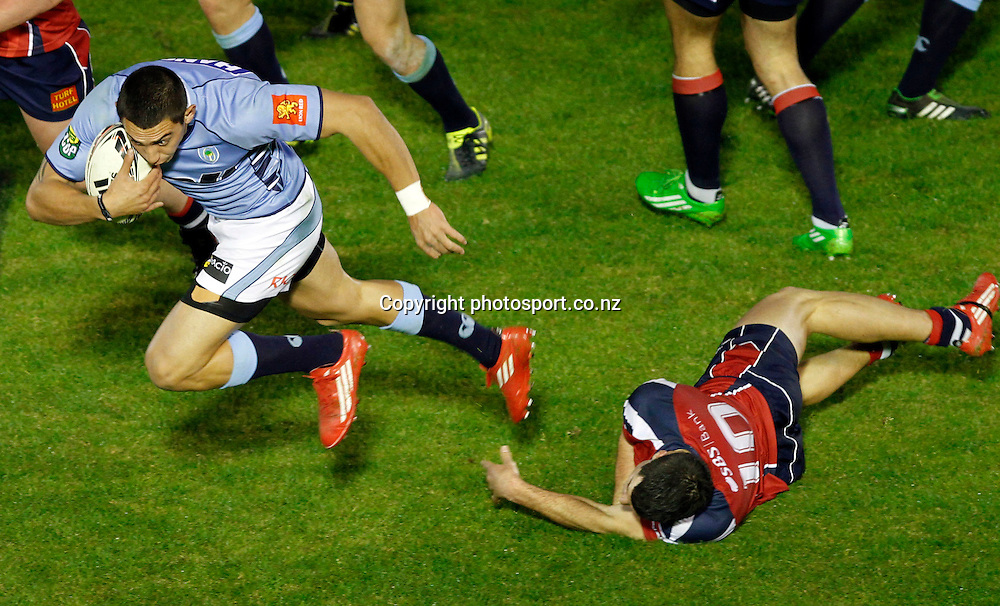 Northland player Bryce Heem slips the tackle of Tasman player James Marshall in the ITM Cup Northland v Tasman, 16 July 2011 played at Toll Stadium Whangarei, New Zealand 16 July 2011. Photo: Kenny Rodger/ photosport.co.nz