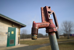 Water hydrant near at the grounds of the former Naval Air Warfare Center Warminster, in Bucks County, Pennsylvania, USA  on February 6, 2019. The United States Environmental Protection Agency (EPA) is expected to release updates on tests of per- and polyfuoroalkyl substances or PFAs pollution in public water supplies for 16 million Americans in 33 states, including Pennsylvania. The federal report is delayed due to January 2019 shutdown. Reps. Brian Fitzpatrick, Republican of Bucks County in Eastern Pennsylvania and Democrat Dan Kildee, of Michigan cochair a bipartisan task force in the House of Representatives, formed to take on the growing PFAS Contamination Crisis. The usage of foam at nearby former military bases is linked to tainted drinking water, affecting tens of thousands of residents in Bucks and Montgomery Counties in Eastern Pennsylvania.