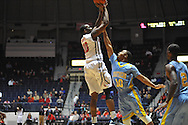 "Ole Miss guard Ladarius White (10) scores against Southern University Jaguars guard Cameron Monroe (10) at the C.M. ""Tad"" Smith Coliseum in Oxford, Miss. on Thursday, November 20, 2014. (AP Photo/Oxford Eagle, Bruce Newman)"