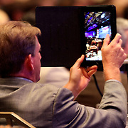 Audience members capture Republican Presidential Nominee and former Massachusetts Governor Mitt Romney as he speaks at the NALEO (National Association of Latino Elected and Appointed Officials) conference at the Disney Contemporary Resort Convention Center in Orlando, Fla. on Thursday, June 21, 2012.(AP Photo/Alex Menendez) Presidential hopeful Mitt Romney speaks to members of NALEO in Orlando, Florida.