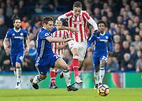 Football - 2016 / 2017 Premier League - Chelsea vs. Stoke City <br /> <br />  Cesar Azpilicueta of Chelsea tries to block the run of Ibrahim Afellay of Stoke City at Stamford Bridge.<br /> <br /> COLORSPORT/DANIEL BEARHAM
