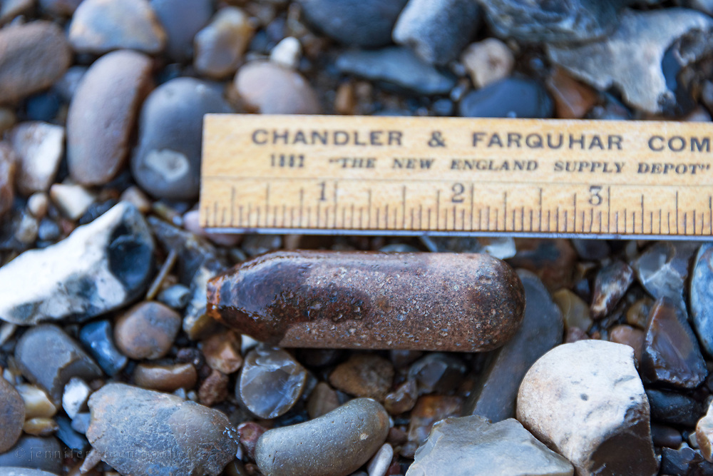 Old CO2 cartridge found on the Thames River foreshore, London, UK.