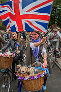 "The Tweed Run - a group bicycle ride through the centre of London, in which the cyclists are expected to dress in traditional British cycling attire, particularly tweed plus four suits. Any bicycle is acceptable on the Tweed Run, but classic vintage bicycles are encouraged in an effort to recreate the spirit of a bygone era. The ride dubs itself ""A Metropolitan Cycle Ride With a Bit of Style."" London 06 May 2017"