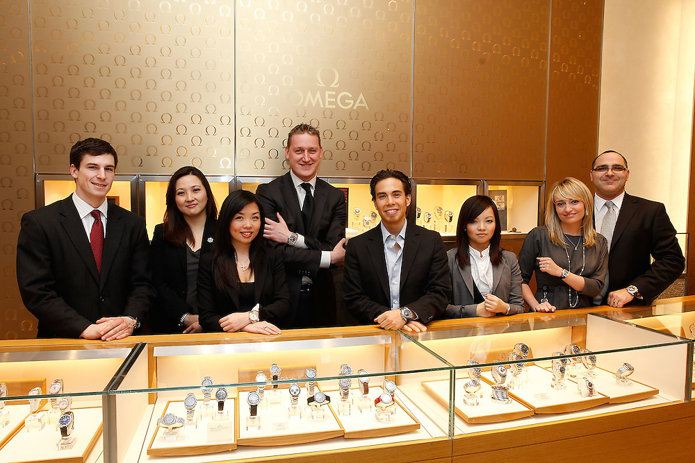 NEW YORK - MARCH 04:  Olympic Medalist and OMEGA Ambassador Apolo Anton Ohno poses for a photo with OMEGA sales team at the Omega Flagship Boutique on March 4, 2010 in New York City.  (Photo by Joe Kohen/Getty Images for OMEGA)