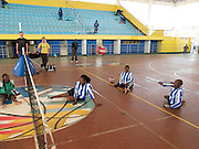 A game of sitting volleyball being played at the National Stadium in Kigali