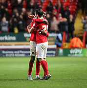 Charlton Athletic defender Morgan Fox celebrating the win with Charlton Athletic midfielder Alou Diarra during the Sky Bet Championship match between Charlton Athletic and Sheffield Wednesday at The Valley, London, England on 7 November 2015. Photo by Matthew Redman.