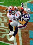New York Giants receiver David Tyree (85) hauls in a long pass against the New England Patriots' Rodney Harrison (37) on the game-winning drive in a 17-14 victory over the New England Patriots in the second half of Super Bowl XLII at University of Phoenix Stadium in Glendale, Arizona, on Sunday, February 3, 2008. (Mark Cornelison/MCT)
