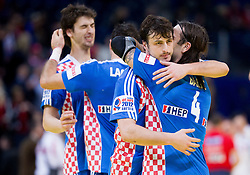 Domagoj Duvnjak of Croatia and Ivano Balic of Croatia celebrate after the handball match between Croatia and Spain for 3rd place game at 10th EHF European Handball Championship Serbia 2012, on January 29, 2012 in Beogradska Arena, Belgrade, Serbia.  Croatia defeated Spain 31-27 and won 3rd place. (Photo By Vid Ponikvar / Sportida.com)