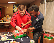 Young adults filling gift boxes