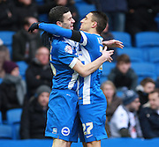 Brighton player Jamie Murphy celebrates with Anthony Knockaert after opening the scoring during the Sky Bet Championship match between Brighton and Hove Albion and Bolton Wanderers at the American Express Community Stadium, Brighton and Hove, England on 13 February 2016. Photo by Bennett Dean.