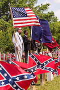 Descendants of Civil War soldiers hold flags at a ceremony marking Confederate Memorial Day at Magnolia Cemetery April 10, 2014 in Charleston, SC. Confederate Memorial Day honors the approximately 258,000 Confederate soldiers that died in the American Civil War.