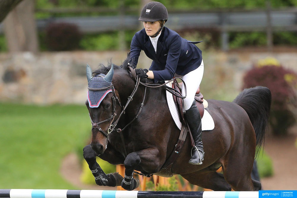 NORTH SALEM, NEW YORK - May 21: Anna Cardelfe riding Dollar Van T Eigenlo DH in action during The $15,000 Under 25 T & R Development Grand Prix at the Old Salem Farm Spring Horse Show on May 21, 2016 in North Salem, New York. (Photo by Tim Clayton/Corbis via Getty Images)