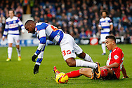 Picture by David Horn/Focus Images Ltd +44 7545 970036<br /> 07/12/2013<br /> Junior Hoilett of Queens Park Rangers is fouled by Adam Henley of Blackburn Rovers during the Sky Bet Championship match at the Loftus Road Stadium, London.