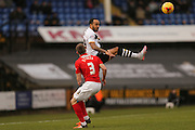 Port Vale forward Byron Moore  wins the header above Coventry City defender Chris Stokes  during the Sky Bet League 1 match between Port Vale and Coventry City at Vale Park, Burslem, England on 7 February 2016. Photo by Simon Davies.
