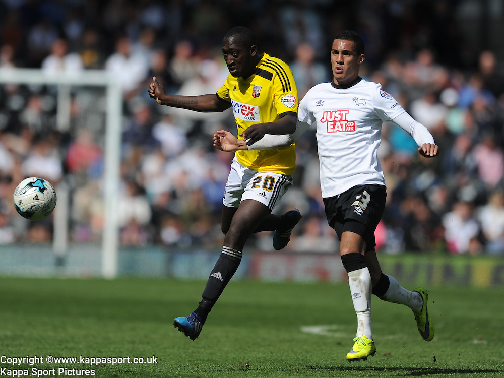 Derby Tom INCE battles with Brenftford Toumani DIAGOURAGA, Derby County v Brentford, Sy Bet Championship, IPro Stadium, Saturday 11th April 2015. Score 1-1,  (Bent 92) (Pritchard 28)<br /> Att 30,050