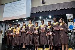 The Class of 2016 stand with their diplomas.  St. Thomas/St. John Seventh Day Adventist School Commencement Service.  Bertha C. Boschulte Auditorium.  St. Thomas, USVI.  12 June 2016.  © Aisha-Zakiya Boyd