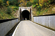 Bicyclists exiting Taft Tunnel along the Hiawatha Rails to Trails Route. Bitterroot Mountains, North Idaho