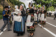 Helene Guillou holds her daughter Morgan before the Great Parade at the Festival de Cornouaille on Sunday, July 24, 2016 in Quimper, France.