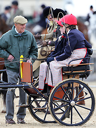 The Duke of Edinburgh talks to two competitors in the Driving for the Disabled competition at the Royal Windsor Horse Show, Thursday,  May 9th 2013.  Photo by: Stephen Lock / i-Images
