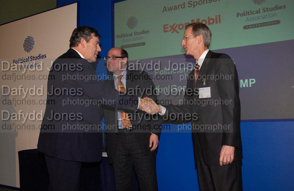 Gordon Brown, Robert Olsen and Nick Robinson, Political Studies Association Awards 2004. Institute of Directors, Pall Mall. London SW1. 30 November 2004.  ONE TIME USE ONLY - DO NOT ARCHIVE  © Copyright Photograph by Dafydd Jones 66 Stockwell Park Rd. London SW9 0DA Tel 020 7733 0108 www.dafjones.com