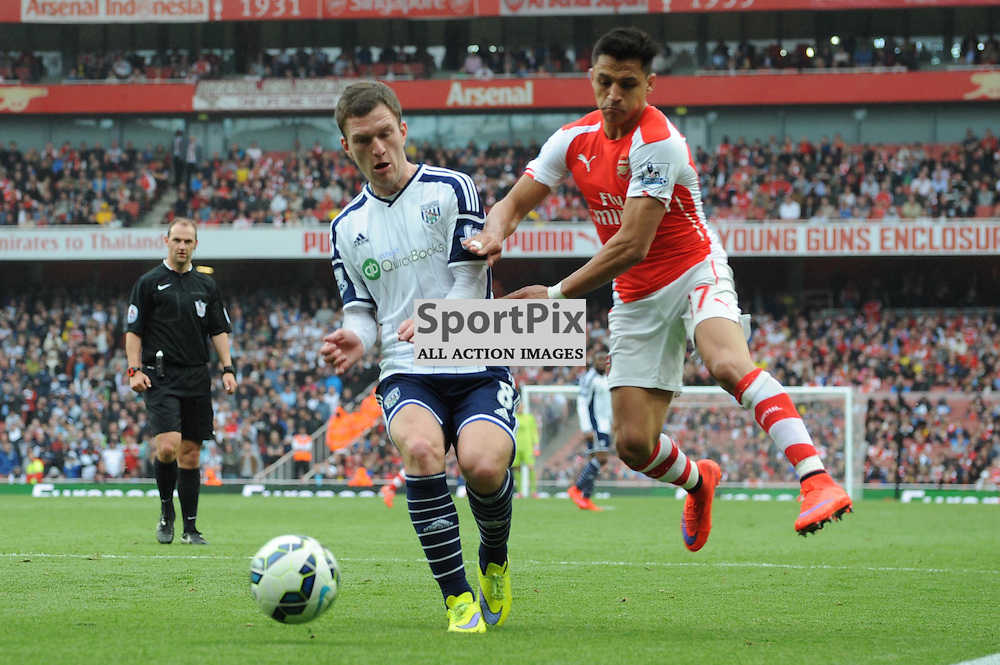 Arsenals Alexis Sanchez and West Broms Craig Gardner in action during the Arsenal v West Brom match on Sunday 24th May 2015