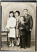 vintage studio family portrait celebration holy communion of boy