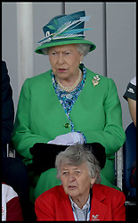 Image ©Licensed to i-Images Picture Agency. 24/07/2014. Glasgow, United Kingdom. HM The Queen and The Duke of Edinburgh watch England playing hockey against Wales at the National Hockey Centre, Glasgow, Scotland . Picture by Andrew Parsons / i-Images