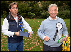 Alan Duncan (right) with his partner James Dunseath as they take part in the Westminster Dog of the Year 2013 with his dog Noodle. London, United Kingdom. Thursday, 10th October 2013. Picture by Andrew Parsons / i-Images