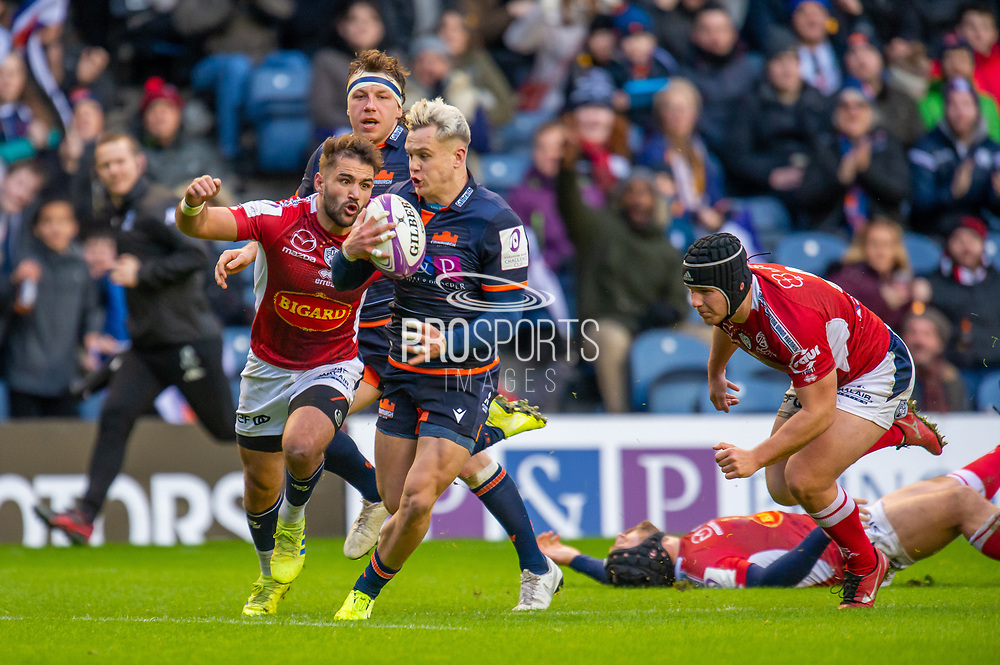 Darcy Graham (#14) of Edinburgh Rugby burst through the SU Agen defence to score the opening try during the European Rugby Challenge Cup match between Edinburgh Rugby and SU Agen at BT Murrayfield, Edinburgh, Scotland on 18 January 2020.