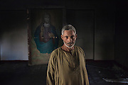 Gerges, a cristian who used to work as janitor of the &ldquo;Association friends of the bible&rdquo; in Fayoum is seen inside a burned room of the center.<br />