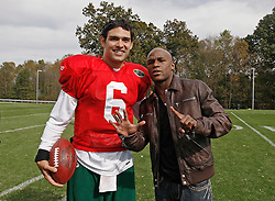 "October 8, 2009; Florham Park, NJ; USA; Floyd ""Money"" Mayweather (r) poses with New York Jets QB Mark Sanchez in Florham Park, NJ."